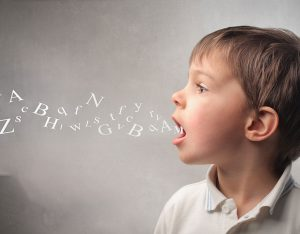 Boy with letters coming out of his mouth
