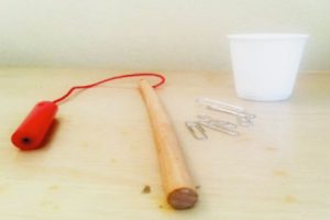 paper clips, cup, magnet fishing pole
