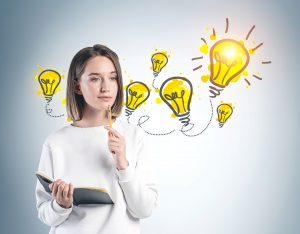 Woman thinking with lightbulbs