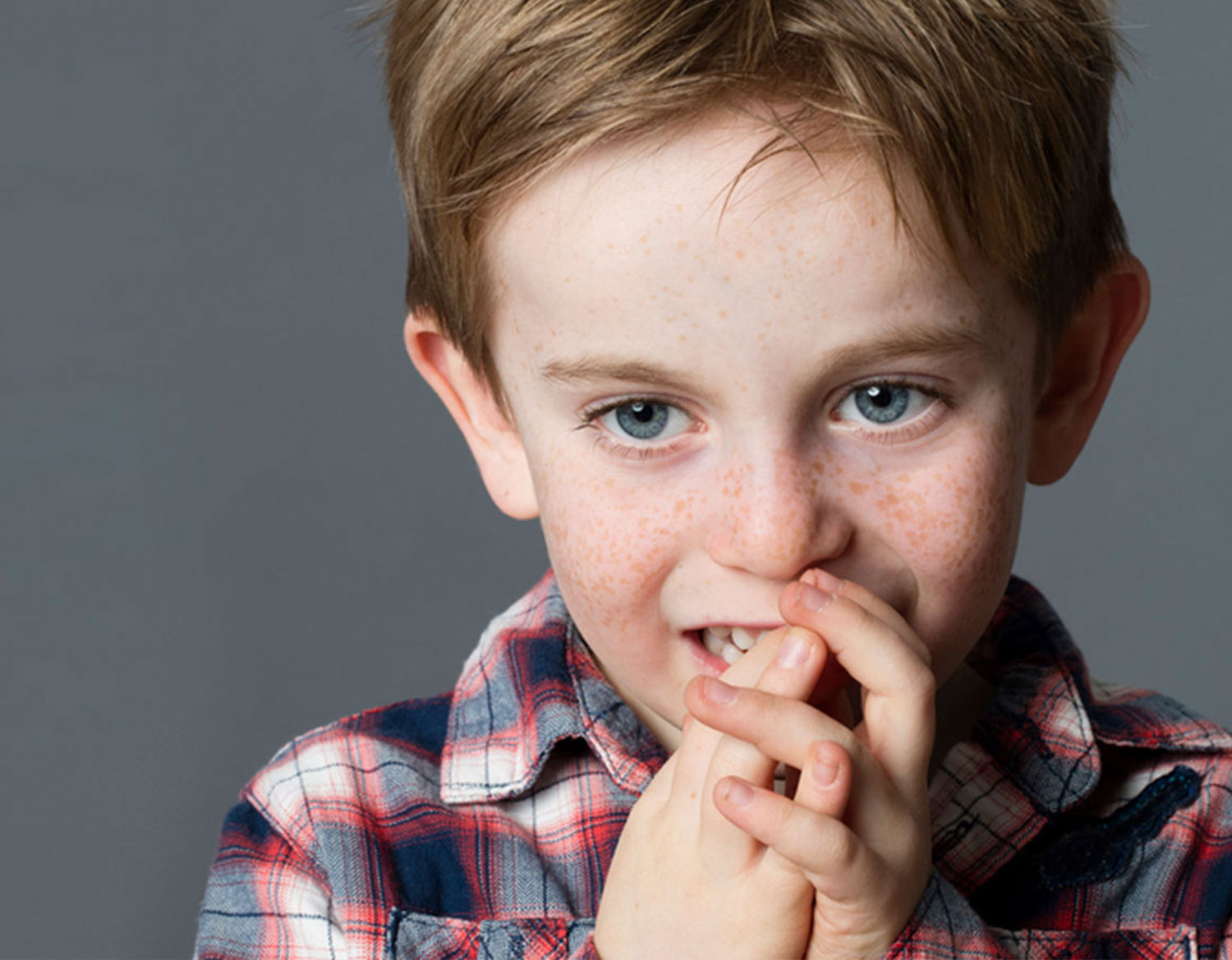boy with hands on face